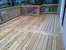 "A-Affordable Decks. A quality deck builder based in Lombard IL  In the photo their ""signature"" decking pattern"