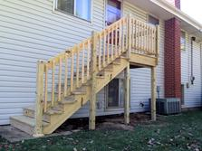 Lemont, Illinois rear landing and staircase (after). A-Affordable Decks of Lombard