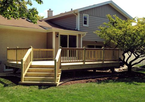 "2014 Treated deck in Darien IL - DuPageDecks.com ""We love it!  We are all excited to use it this coming weekend.  Thank you so much; the design fits our house/setup perfectly, and you can see the quality craftsmanship right away"""
